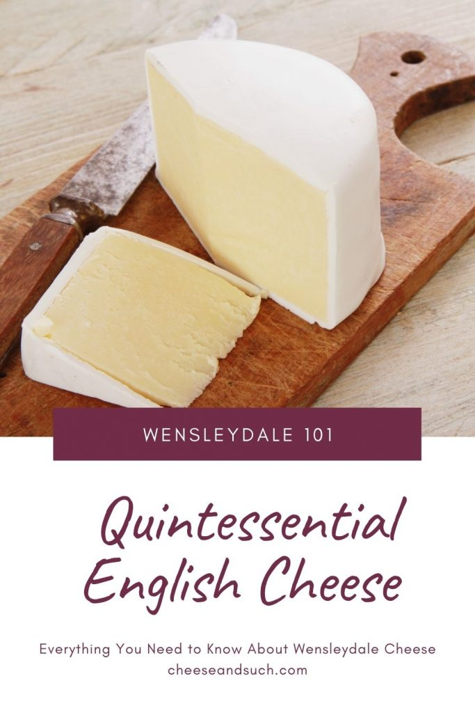 A pinterest pin with an image of traditional waxed Wensleydale Cheese on a wooden cutting board with a cheese knife nearby. The text says Wensleydale 101: Quintessential English Cheese - Everything You Need to Know About Wensleydale Cheese