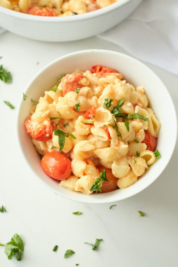 A bowl of feta, tomato and basil baked pasta inspired by TikTok