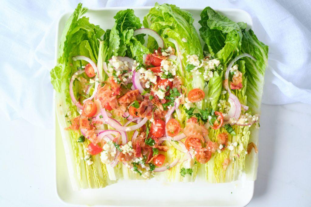 A romaine wedge salad with gorgonzola vinaigrette