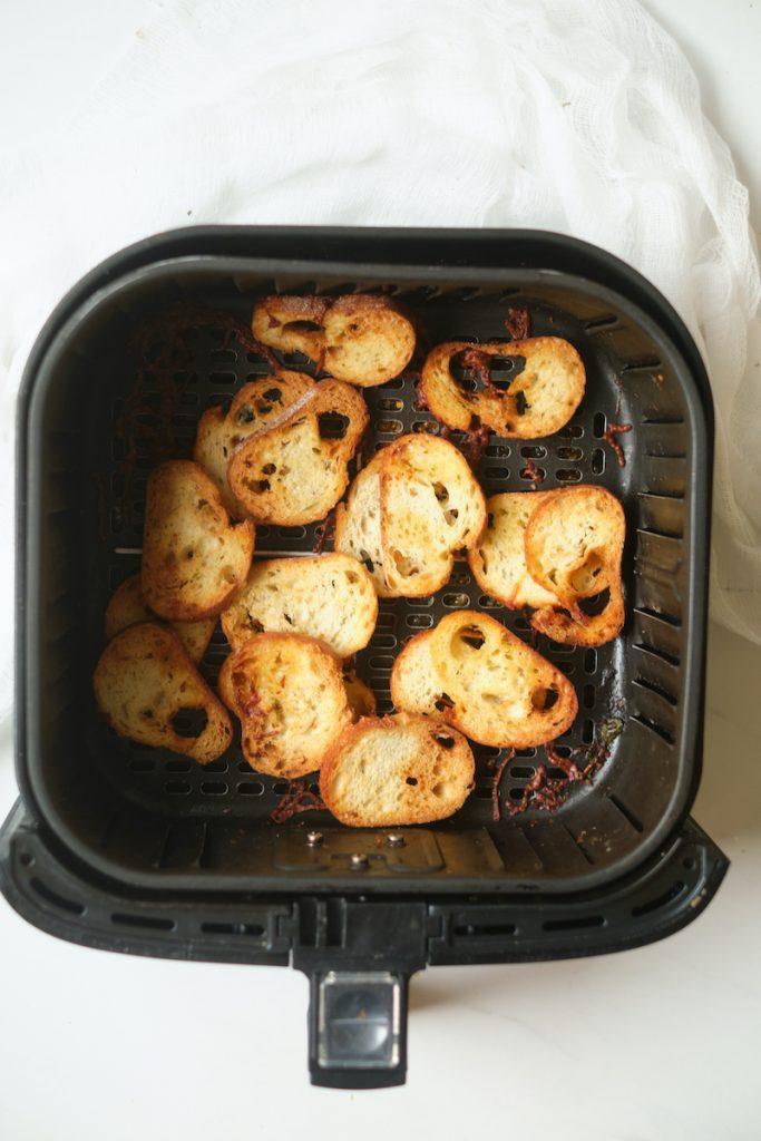 homemade garlic Parmesan baguette crisps in an air fryer after baking